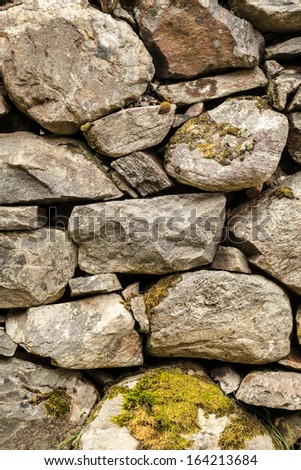 Wall made of rocks or cobblestones - stock photo