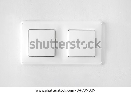 wall-mounted white double light switch - stock photo