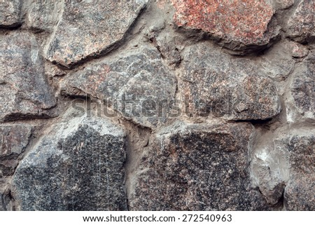 Wall. Natural granite stone texture background. Rough and rusty. Close-up, macro