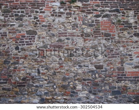 Wall of a an old bastion (Prague, 17 th century). Combination of bricks and stones.