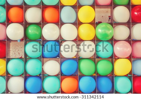 Wall of balloons, some popped. Carnival dart game.  Filtered Instagram image. - stock photo