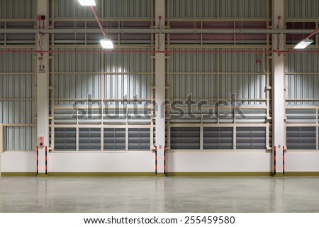 Wall of factory with steel frame, night time. - stock photo