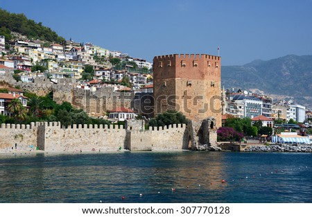 Wall of fortress and Red Tower (Kizilkule) in Alanya, Turkey  - stock photo