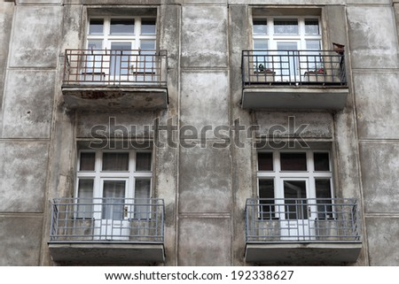 Wall of grey building in old Prague