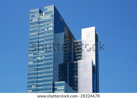 Wall of modern office building and sky reflection - stock photo