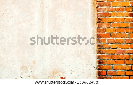 Wall of old brick and white plaster