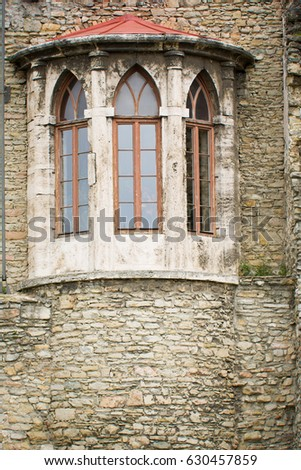 Wall Of Old Medieval Castle Detail With Gothic Windows