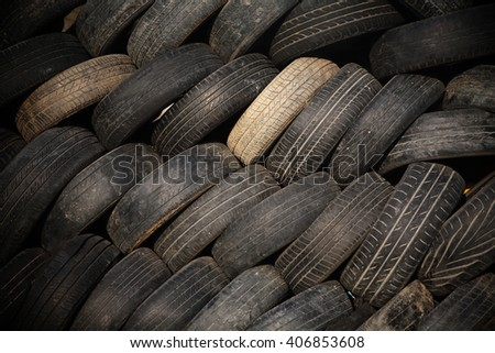 wall of old stack tires for textured background - stock photo