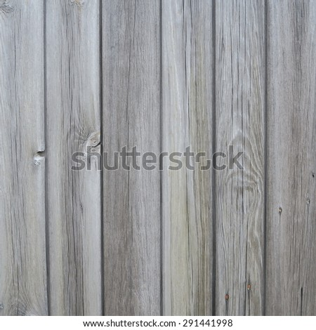 Wall of old weathered planks of wood in natural color - stock photo