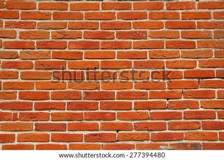 Wall of orange annealed bricks as background or texture