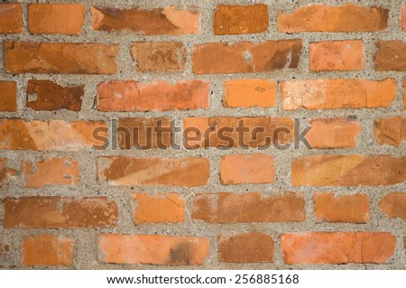 Wall of red bricks. Background. - stock photo