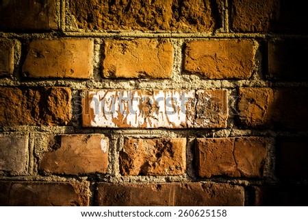 Wall of red bricks. Background. Toned.