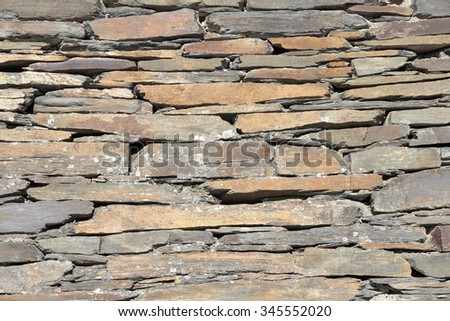 wall of slate bricks. Slate is typical of the villages of black architecture in the province of Guadalajara-Spain - stock photo