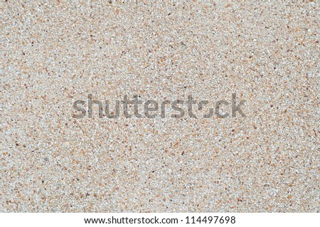 Wall of small multicolored stones - stock photo
