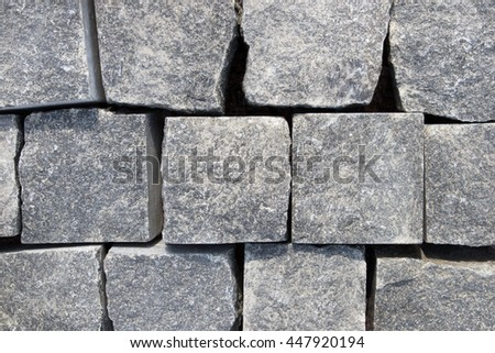 Wall of square stone blocks stacked on one another - stock photo