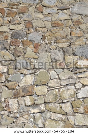 Wall of stones. Background. Rough masonry. Stones of different sizes and colors.