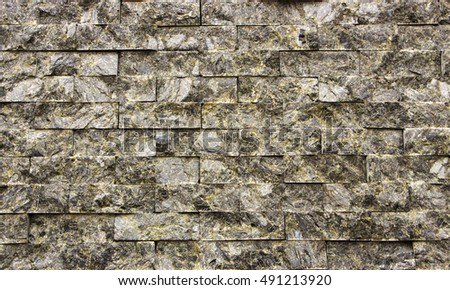 wall of the small granite blocks close-up