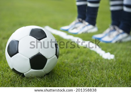 Wall of two soccer player standing behind foam spray free kick line - stock photo