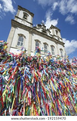 Wall of wish ribbons blowing in the wind at the famous Igreja Nosso Senhor do Bonfim da Bahia church in Salvador Bahia Brazil  - stock photo