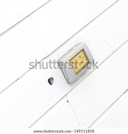Wall outlet , Electric outlet on the wall covered with wallpaper