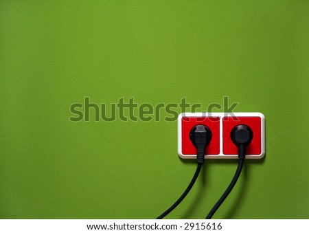 Wall outlets on the green wall - stock photo