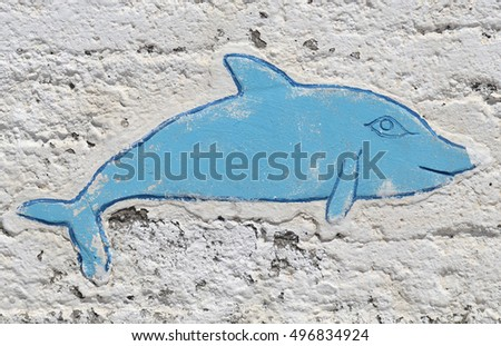 Wall painting / mural of a dolphin in Greece
