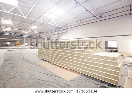 Wall Panels in Modern high-tech factory workshop construction site - stock photo