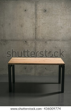 wall panels with concrete, style loft, minimalism. wooden table