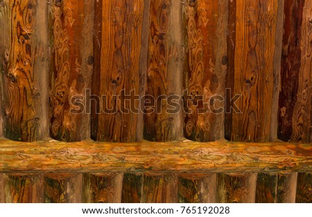 Wall pine log, background fence natural texture with patina, vertical lines with cross bar