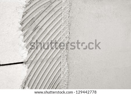 Wall plaster mesh and glue - stock photo