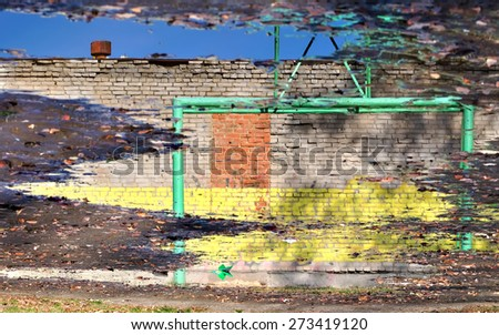 wall reflected in a puddle - stock photo
