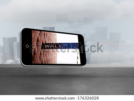 Wall street on smartphone screen against cityscape in the fog