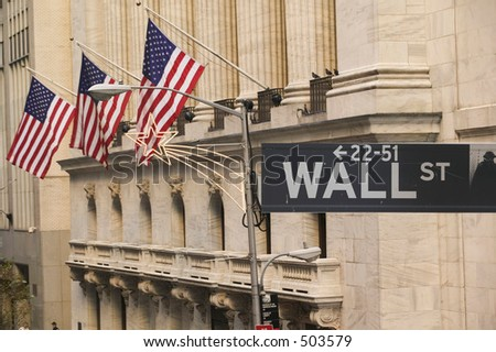 Wall Street sign in front of the New York Stock Exchange