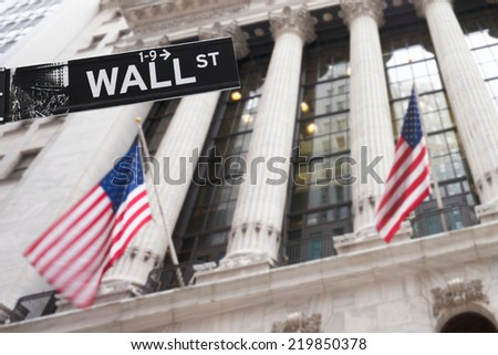 Wall street sign in New York, 20 January 2014 - New York Stock Exchange background - stock photo
