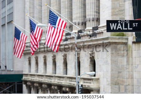 Wall street sign in New York with New York Stock Exchange background - stock photo