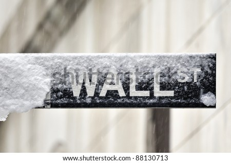 Wall street sign in snow - stock photo