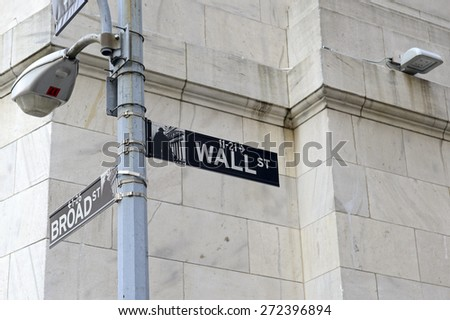 Wall Street sign on road, lower downtown Manhattan - stock photo