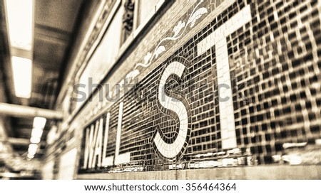 Wall street subway station sign, New York. - stock photo