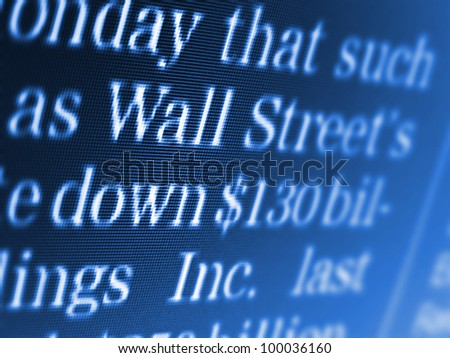 Wall street text on a computer screen. Selective focus.