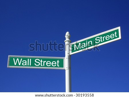 Wall street vs Mainstreet conceptual sign against a clear blue sky - stock photo