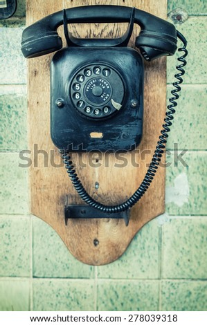 Wall telephone as an split image and colored transfer. - stock photo