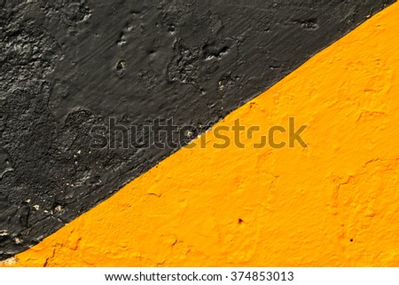 Wall with black and yellow.