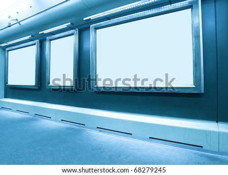 wall with blank frames - stock photo