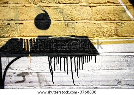 Wall with bricks close up abstract dot and drip graffiti - stock photo