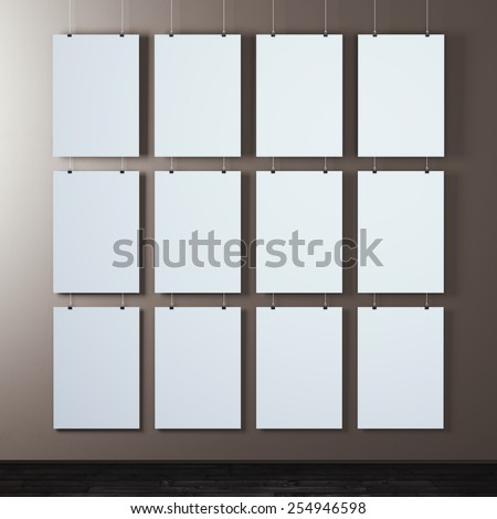 wall with many white poster - stock photo