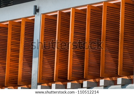 Wall with open wooden window shutters - stock photo