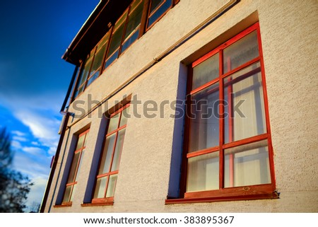 wall with three wooden windows in perspective
