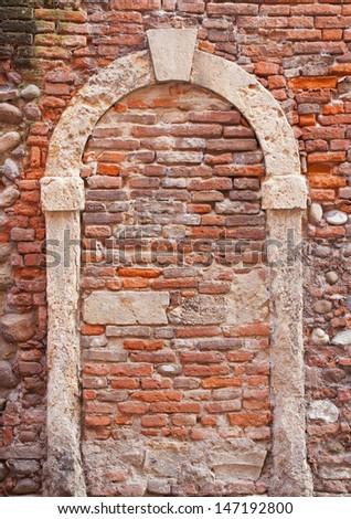 walled door of old house in Verona - stock photo