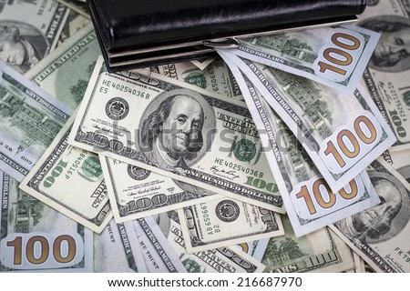 Wallet and a lot of american dollars. Macro - stock photo
