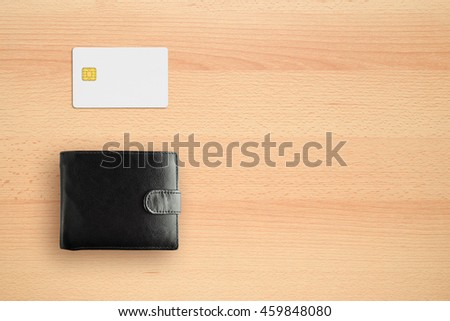 Wallet and credit card on desk top view - stock photo